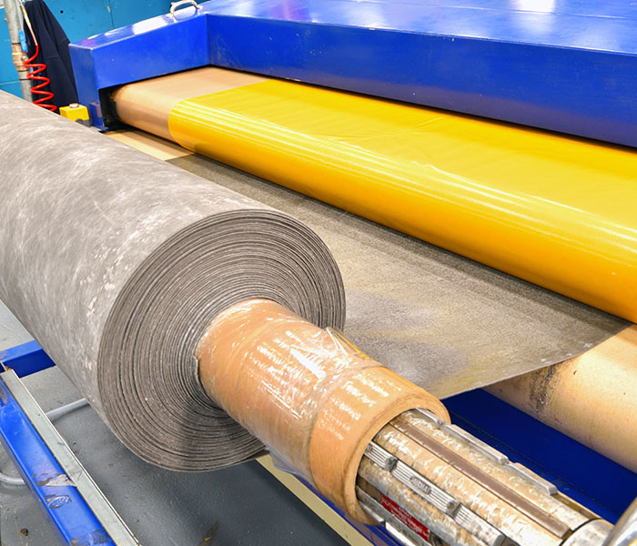 Roll of fabric being fed into machine