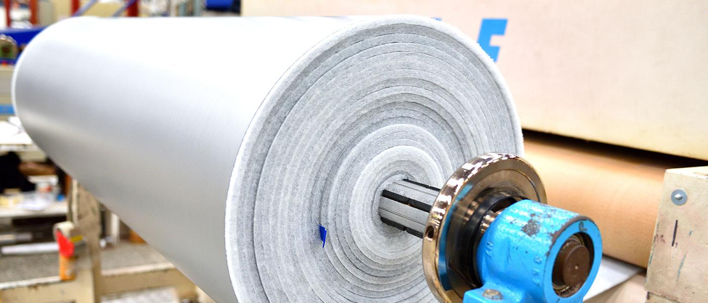 Roll of multi-layer foam backing on machine